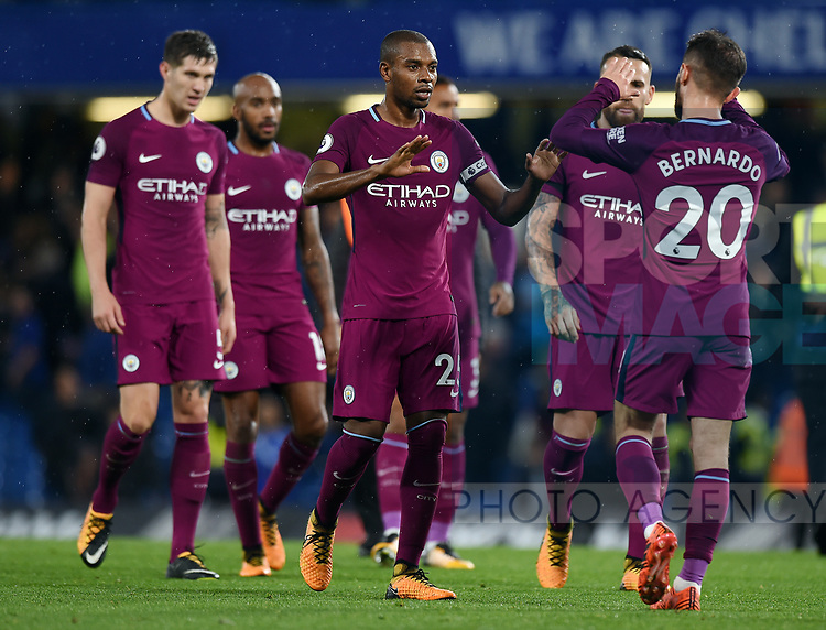Fernandinho of Manchester City celebrates with team mate Bernardo Silva of Manchester City at the end of the premier league match at the Stamford Bridge stadium, London. Picture date 30th September 2017. Picture credit should read: Robin Parker/Sportimage