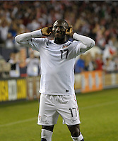 US forward Jozy Altidore (17) encourages the crowd to cheer after his goal put the US ahead 1-0.  The U.S. Men's National Team tied Poland 2-2 at Soldier Field in Chicago, IL on October 9, 2010.