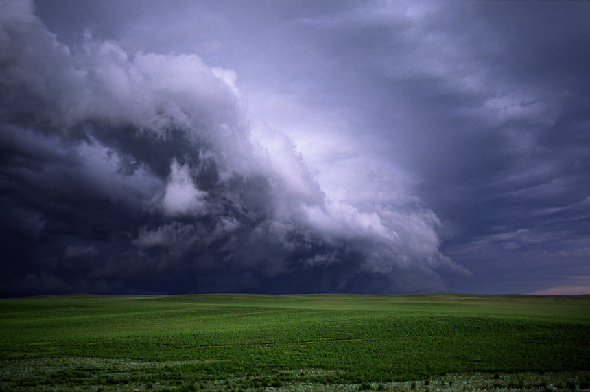 Ragged fractus clouds associated with a gustfront from a severe thunderstorm sweep across the grasslands of western Nebraska in June.