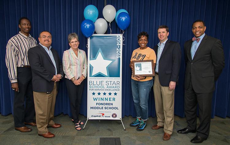 Fondren Middle School principal Monique Lewis is awarded the Blue Star School Award for Service Excellence, April 24, 2015.