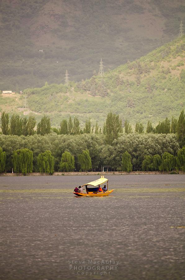 Traditional Kashmiri shikara on Dal Lake, Srinagar, India.