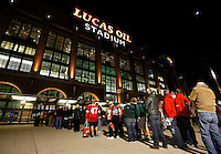 Fans stream into Lucas Oil Stadium prior to the Big Ten championship football game between the Ohio State Buckeyes and the Michigan State Spartans in Indianapolis on Dec. 7, 2013. (Adam Cairns / The Columbus Dispatch)
