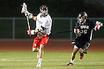 Torrance, CA 05/08/13 - Tony Romeri (Palos Verdes #9) and Clay Davis (Harvard Westlake #38) in action during the Harvard Westlake vs Palos Verdes Los Angeles area Lacrosse Championship game.  Harvard Westlake defeated Palos Verdes 9-7.