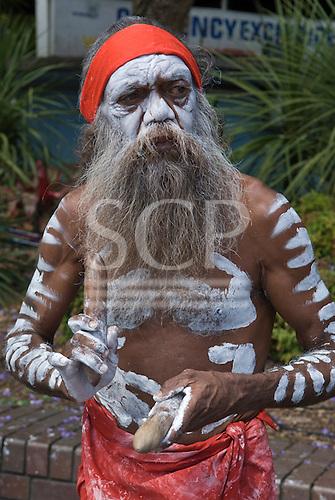 Sydney, Australia. Aborigine musician playing traditional clap sticks.