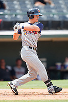 Chris White #9 of the Toledo Mudhens follows through on his swing against the Charlotte Knights at Knights Stadium August 8, 2010, in Fort Mill, South Carolina.  Photo by Brian Westerholt / Four Seam Images