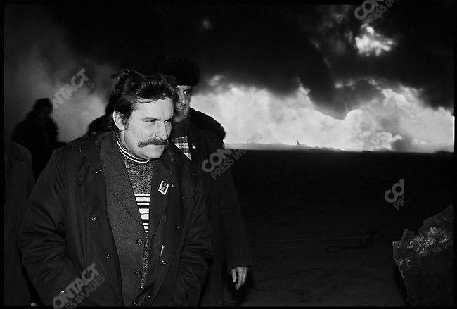 Lech Walesa, leader of the Solidarity Labor Union, visiting the site of an oil rig fire near Koscalin, in the northwestern part of the country. Koscalin, Poland, December 1980