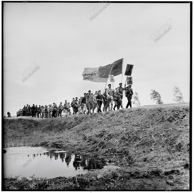 Writers and artists from Harbin march in the countryside south of Harbin to participate in manual labor; Wuchang County; Heilongjiang Province, August 18, 1968