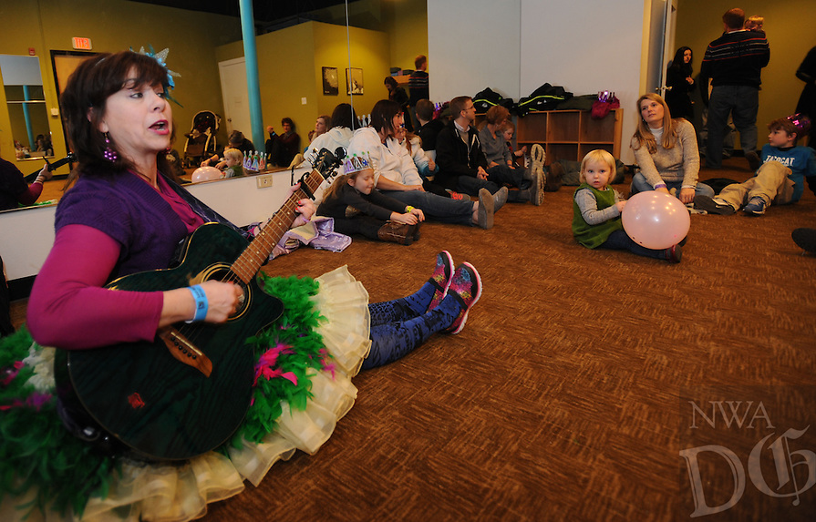 NWA Democrat-Gazette/ANDY SHUPE<br /> Jules Taylor of Shaky Bugs performs Thursday, Dec. 31, 2015, at Terra Tots during the fifth annual Last Night Fayetteville celebration on the town's square. The celebration featured music and performances for all ages on 11 stages leading up to the Hog Drop and fireworks at midnight. Visit nwadg.com/photos to see more photographs from the event.