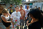 A woman adjusts a money apron on the groom in a wedding in Suto Orizari, Macedonia. The mostly Roma community, located just outside Skopje, is considered Europe's largest Roma settlement..