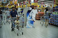 an ad billboard featuring David Beckham  in a French retail giant Carrefour supermarket in Beijing, China..24 Jul 2005