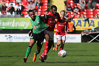 Funso Ojo of Scunthorpe United and Charlton Athletic's Anfernee Dijksteel challenge for the ball during Charlton Athletic vs Scunthorpe United, Sky Bet EFL League 1 Football at The Valley on 14th April 2018