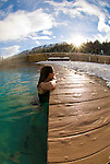 A young woman soaks in the steamy waters of Granite Hot Springs near Jackson Hole, Wyoming.