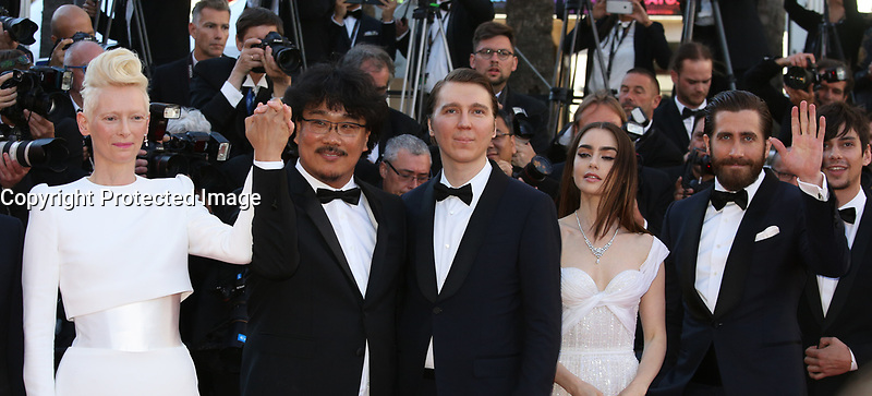 TILDA SWINTON, DIRECTOR BONG JOON-HO, PAUL DANO, LILY COLLINS, JAKE GYLLENHAAL AND DEVON BOSTICK - RED CARPET OF THE FILM 'OKJA' AT THE 70TH FESTIVAL OF CANNES 2017