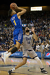 South Dakota State guard Skyler Flatten (1) shoots over Nevada's Caleb Martin (10) in the second half of an NCAA college basketball game in Reno, Nev., Saturday, Dec. 15, 2018. (AP Photo/Tom R. Smedes)