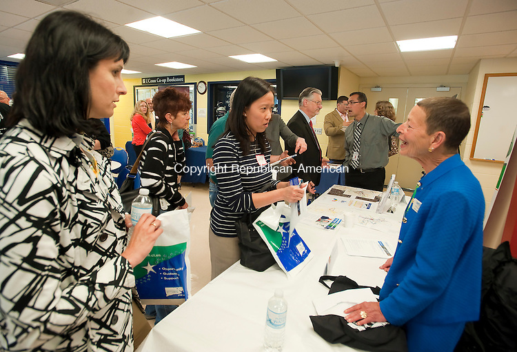 TORRINGTON, CT-061214JS03--Kathy Ricci, a CPA with Bowman Monaco &amp; Black, left, and Lucy Casavant, Accounting Manager with FCT, a Molex Company, center, talks with Lindy Lee Gold of the Department of Economic and Community Development, right, during an event Thursday at UConn Torrington, to promote the state's STEP UP program which provides aid to small businesses that want to expand. The event was hosted by local  and the CT Labor Department. <br />  Jim Shannon Republican-American