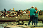 An unidentified couple watches as volunteers and rescue workers dig through the debris of a recycling facility in Jarrell, Texas. The plant was destroyed by a tornado on May 27, 1997. (Temple Daily Telegram/Matthew Crawley, File)