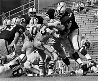Oakland Raiders against the Boston Patroits, Ben Davidson and Ike Lassiter put the HIT on QB Babe Parilli, (1969 photo/Ron Riesterer)
