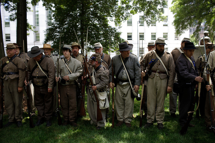 Civil War re-enactors from the 26th NC Infantry on the grounds of the Old State Capitol, Saturday, May 21, 2011, gather to hear the declaration of secession from the Union 150 years after it was signed.