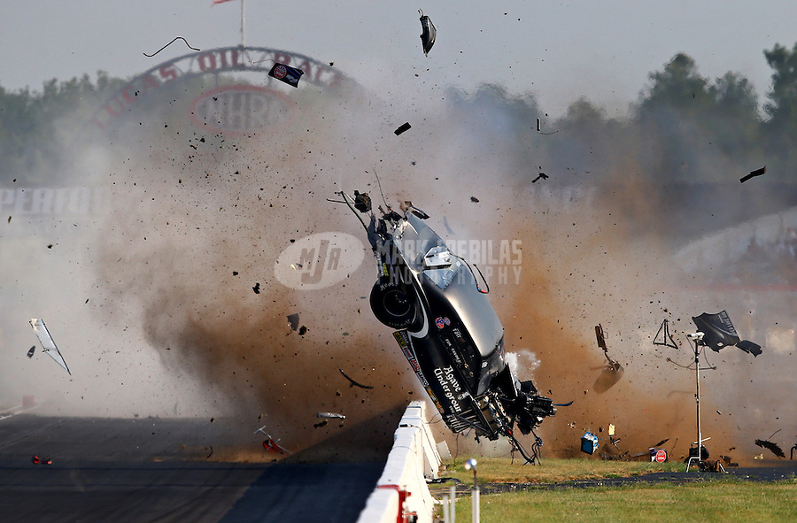 Sept. 1, 2013; Clermont, IN, USA: NHRA pro mod driver Tim Tindle crashes during qualifying for the US Nationals at Lucas Oil Raceway. Tindle walked away from the accident. Mandatory Credit: Mark J. Rebilas-