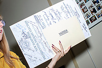 A State House employee holds the ceremonial ballot signed by all candidates as Democratic presidential candidate and Massachusetts senator Elizabeth Warren filed paperwork to get on the primary ballot at the NH State House in Concord, New Hampshire, on Wed., November 13, 2019. Warren also held a small rally outside the State House after filing her paperwork.