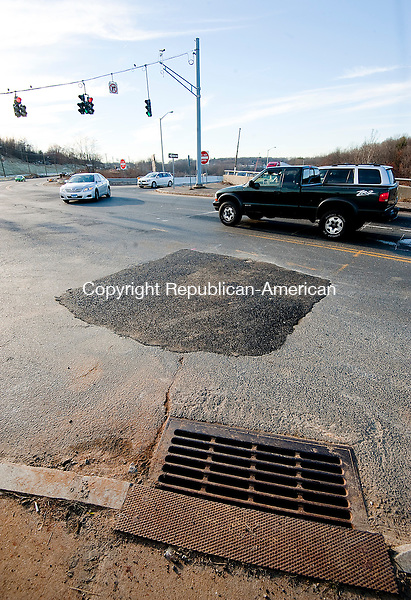 WATERBURY, CT--- -010716JS06--Fresh patch of asphalt on Harpers Ferry Road in Waterbury after crews repaired a broken water main from Wednesday night. <br /> Jim Shannon Republican-American