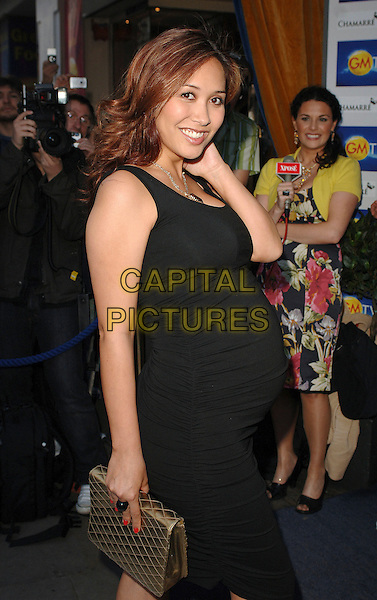 MYLEENE KLASS.attending the LK High Street Fashion Awards, Cafe de Paris, London, England, 14th May 2007..half length black dress gold clutch bag pregnant .CAP/BEL.©Tom Belcher/Capital Pictures.