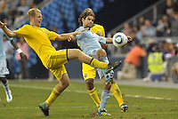 Kevin Burns (yellow) Columbus Crew challenges Graham Zusi (8) Sporting KC for the ball... Sporting Kansas City defeated Columbus Crew 2-1 at LIVESTRONG Sporting Park, Kansas City, Kansas.