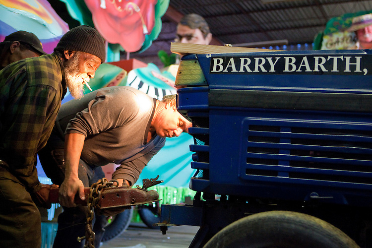 Y.A., left, helps Barry Barth secure a float to a tractor at Barry Barth (Artists and Designers), a Mardi Gras float building company in New Orleans on February 2, 2010.