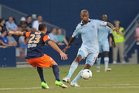 Julio Cesar (55) midfield Sporting KC watched by Jamel Saihi (23) midfield Montpellier..Sporting Kansas City were defeated 3-0 by Montpellier HSC in an international friendly at LIVESTRONG Sporting Park, Kansas City, KS..