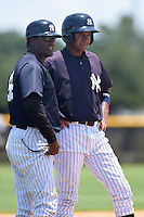 GCL Yankees 1 coach Michel Hernandez (54) and outfielder Leonardo Molina (18) during the first game of a doubleheader against the GCL Braves on July 1, 2014 at the Yankees Minor League Complex in Tampa, Florida.  GCL Yankees 1 defeated the GCL Braves 7-1.  (Mike Janes/Four Seam Images)