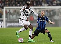 Calcio, Serie A: Juventus vs Inter. Torino, Juventus Stadium, 28 February 2016.<br /> Juventus&rsquo; Paul Pogba, left, is challenged by Inter's Rodrigo Palacio during the Italian Serie A football match between Juventus and Inter at Turin's Juventus Stadium, 28 February 2016.<br /> UPDATE IMAGES PRESS/Isabella Bonotto