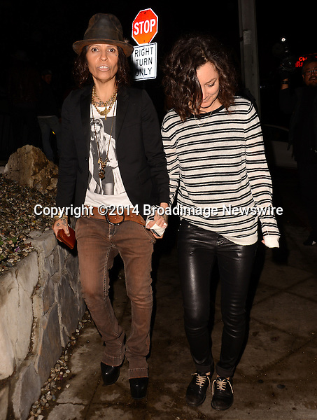 Pictured: Linda Perry, Sara Gilbert<br /> Mandatory Credit: Luiz Martinez / Broadimage<br /> Annie Leibovitz Book Launch - Outside Arrivals<br /> <br /> 2/26/14, West Hollywood, California, United States of America<br /> Reference: 022614_LMLA_BDG_096<br /> <br /> sales@broadimage.com<br /> Bus: (310) 301-1027<br /> Fax: (646) 827-9134<br /> http://www.broadimage.com