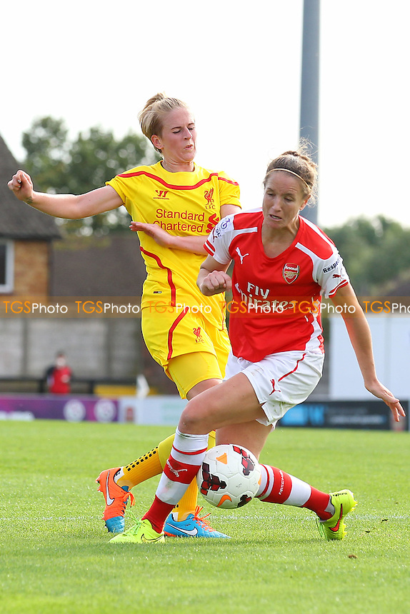 Natasha Dowie of Liverpool Ladies tangles with Casey Stoney of Arsenal Ladies - Arsenal Ladies vs Liverpool Ladies - FA Womens Super League Football at Meadow Park, Boreham Wood FC  - 05/10/14 - MANDATORY CREDIT: Gavin Ellis/TGSPHOTO - Self billing applies where appropriate - contact@tgsphoto.co.uk - NO UNPAID USE
