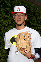 Anthony Molina (23) of Somerset Academy in Pembroke Pines, Florida poses for a photo during practice before the Under Armour All-American Game on August 16, 2014 at Wrigley Field in Chicago, Illinois.  (Mike Janes/Four Seam Images)