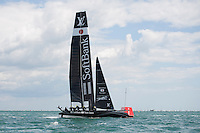 25 July 2015: SoftBank Team Japan in action during the America's Cup first round racing off Portsmouth, England (Photo by Rob Munro)