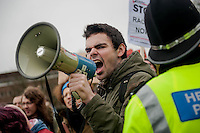 Saturday 05 April 2014<br /> Pictured: An anti fascist campaigner rallies supporters using a megaphone<br /> Re: White Pride and Anti Fascist groups protest in Swansea City Cebtre