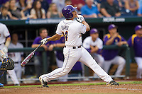 LSU Tiger third baseman Christian Iberra (14) follows through on his swing during Game 4 of the 2013 Men's College World Series against the UCLA Bruins on June 16, 2013 at TD Ameritrade Park in Omaha, Nebraska. UCLA defeated LSU 2-1. (Andrew Woolley/Four Seam Images)