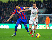 Crystal Palace's Luka Milivojevic vies for possession with Burnley's Ashley Barnes<br /> <br /> Photographer Ashley Crowden/CameraSport<br /> <br /> The Premier League - Crystal Palace v Burnley - Saturday 13th January 2018 - Selhurst Park - London<br /> <br /> World Copyright &copy; 2018 CameraSport. All rights reserved. 43 Linden Ave. Countesthorpe. Leicester. England. LE8 5PG - Tel: +44 (0) 116 277 4147 - admin@camerasport.com - www.camerasport.com