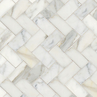 "Herringbone 3"" x 6"", a hand-cut stone mosaic, shown in polished in Calacatta Tia."