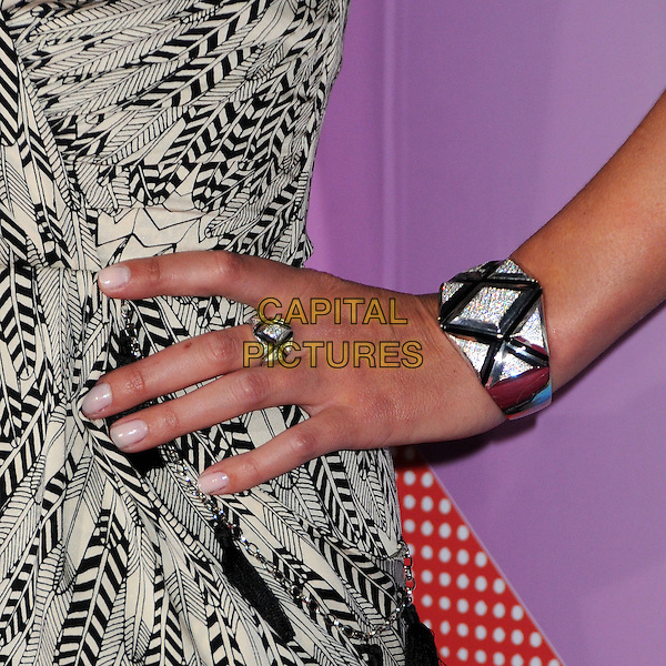 NICKY HILTON's hand.The T-Mobile Sidekick 4G Launch Party held at a private lot in Beverly Hills, California, USA..April 20th 2011.detail bracelet ring silver .CAP/ADM/BP.©Byron Purvis/AdMedia/Capital Pictures.