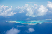 """An aerial view of Funafuti atoll, on approach to land at the country's sole airport. Seen from above, it's easy to see why the Southwest Pacific country of Tuvalu has been identified as one of the world's most vulnerable nations to climate change. The country is made up of a collection of small islands and coral atolls, totalling only 27 square kilometres, scattered over 500,000 square kilometres of ocean. The highest point throughout the country is only 5 metres above sea level, resulting in special vulnerability to sea level rise. According to the Tuvaluan government, """"since 1993, sea level near Tuvalu has risen about 5mm per year; this is larger than the global average."""" Other challenges face the country including drought, ocean acidification and waste problems. Tuvalu. March, 2019."""
