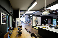 Wooden dining table in art studio