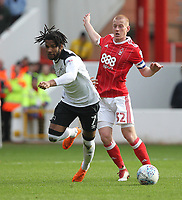 Nottingham Forest's Ben Watson in action with Derby County's Kasey Palmer<br /> <br /> Photographer Mick Walker/CameraSport<br /> <br /> The EFL Sky Bet Championship - Nottingham Forest v Derby County - Sunday 11th March 2018 - The City Ground - Nottingham<br /> <br /> World Copyright &copy; 2018 CameraSport. All rights reserved. 43 Linden Ave. Countesthorpe. Leicester. England. LE8 5PG - Tel: +44 (0) 116 277 4147 - admin@camerasport.com - www.camerasport.com