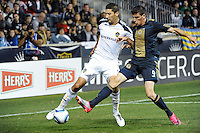 Omar Gonzalez (4) of the Los Angeles Galaxy and Sebastien Le Toux (9) of the Philadelphia Union. The Los Angeles Galaxy defeated the Philadelphia Union  1-0 during a Major League Soccer (MLS) match at PPL Park in Chester, PA, on October 07, 2010.