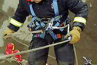 Fire service line rescue unit attending an incident where a workman has been become trapped and injured whilst working on the side of a tower building. He was using a cradle type seat in which he became trapped. The firefighters have to release him and lower him to the ground by means of rope after placing a harness on him...© SHOUT. THIS PICTURE MUST ONLY BE USED TO ILLUSTRATE THE EMERGENCY SERVICES IN A POSITIVE MANNER. CONTACT JOHN CALLAN. Exact date unknown.john@shoutpictures.com.www.shoutpictures.com...