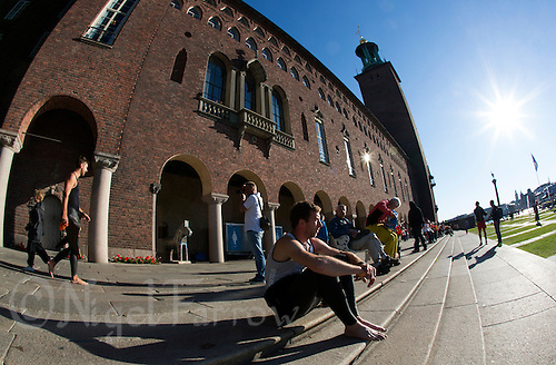 25 AUG 2013 - STOCKHOLM, SWE - A competitor waits for his wave start of the Stockholm Triathlon in front of Stockholm City Hall, Stockholm, Sweden (PHOTO COPYRIGHT © 2013 NIGEL FARROW, ALL RIGHTS RESERVED)