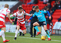 Conor McAleny of Fleetwood Town wins the ball against Alfie Beestin of Doncaster Rovers during the Sky Bet League 1 match between Doncaster Rovers and Fleetwood Town at the Keepmoat Stadium, Doncaster, England on 17 February 2018. Photo by Leila Coker / PRiME Media Images.