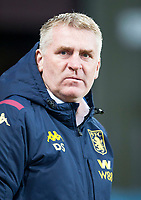 30th October 2019; Villa Park, Birmingham, Midlands, England; English Football League Cup, Carabao Cup, Aston Villa versus Wolverhampton Wanderers; Aston Villa Head Coach Dean Smith watching his players on the pitch warming up before the match - Strictly Editorial Use Only. No use with unauthorized audio, video, data, fixture lists, club/league logos or 'live' services. Online in-match use limited to 120 images, no video emulation. No use in betting, games or single club/league/player publications
