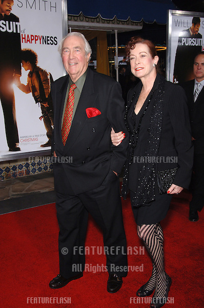 "JAMES KAREN & wife at the world premiere of ""The Pursuit of Happyness"" at the Mann Village Theatre, Westwood..December 7, 2006  Los Angeles, CA.Picture: Paul Smith / Featureflash"