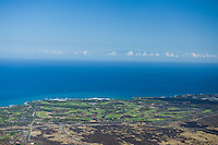 Aerial view of Hualalai Golf Course with Haleakala in background